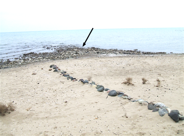 The lake shore where the stone was discovered.